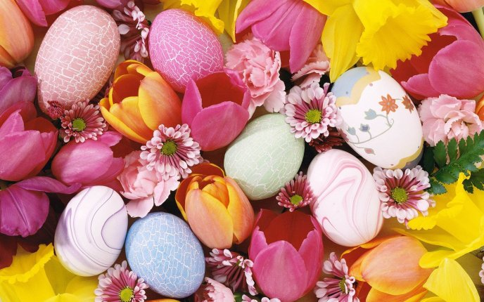 A bed of flowers and colored eggs