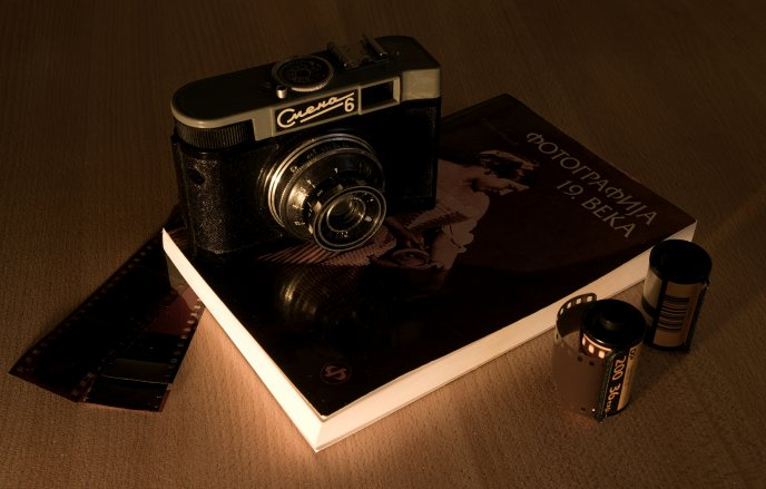 An old camera and book about photography