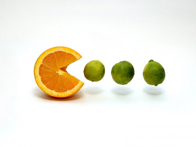 An orange pacman eat some limes
