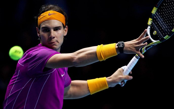 Rafael Nadal hit the tennis ball with power -sport wallpaper