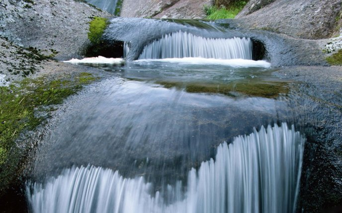 Cool And Refreshing Water Of A Waterfall