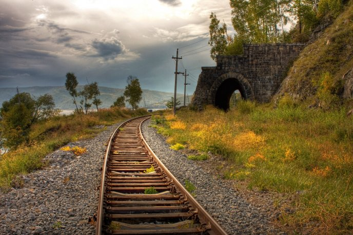 Old rails entering in a tunnel - HD nature landscape