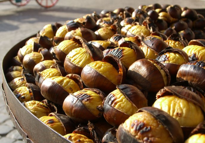 A pan full of roasted chestnuts - autumn fruits