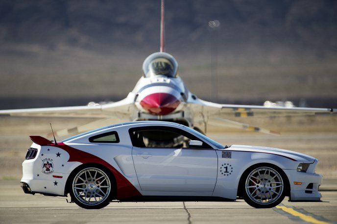 White car on an aircraft runway - beautiful Mustang 2014
