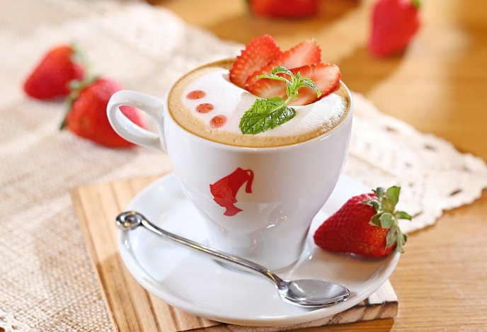 Fresh summer coffee with strawberry and mint