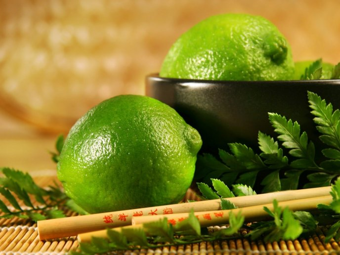 Green lime and Chinese sticks - HD wallpaper