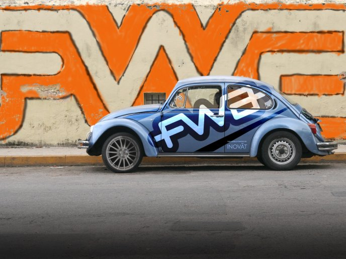 Old Volkswagen Beetle - beautiful graffiti on the wall