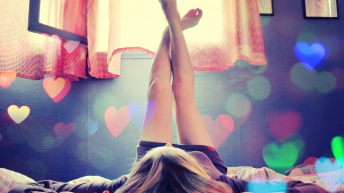 Download Wallpaper Lovely girl sitting on the bed looking at the ceiling