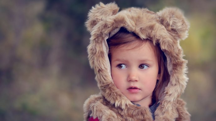 Download Wallpaper Sweet baby girl with bearskin
