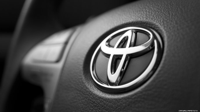Toyota logo on the car - HD wallpaper