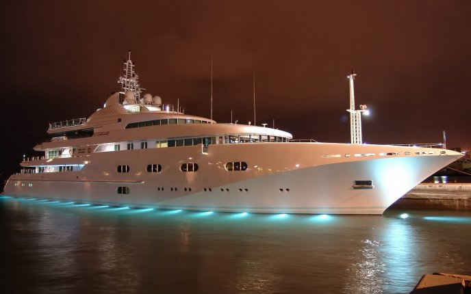 Beautiful white yacht lighted on the water in the night