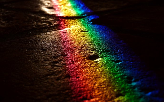 Rainbow on the road in the night