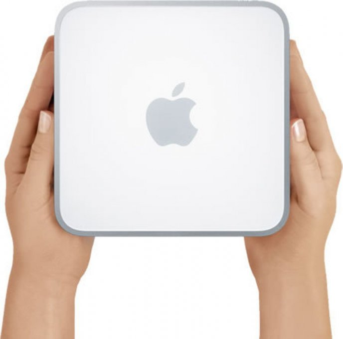 Apple Mac Mini in the hands - Apple logo