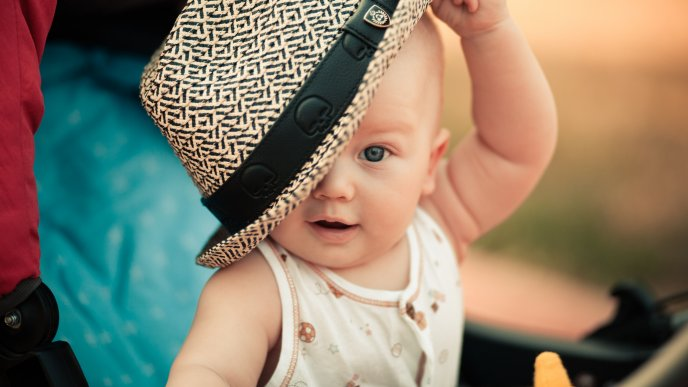A cute baby boy with the hat an the head