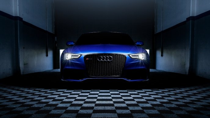 Blue Audi RS 5 in a dark space - Car wallpaper