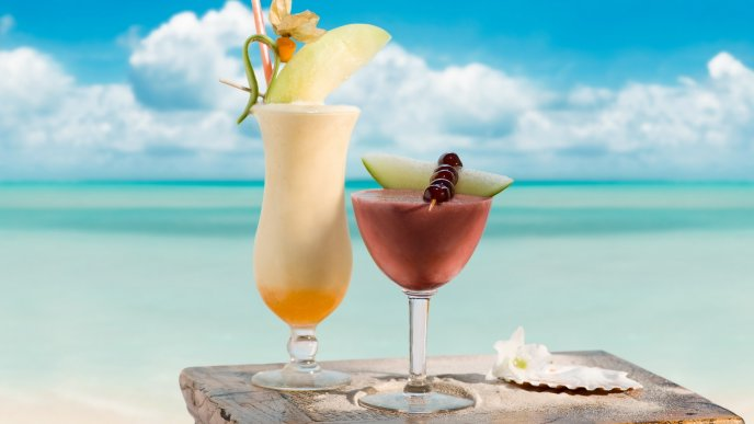 Fresh cocktails on the beach - summer holiday