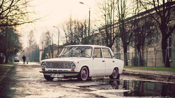 White Old Car Lada On The Road - Old car photos