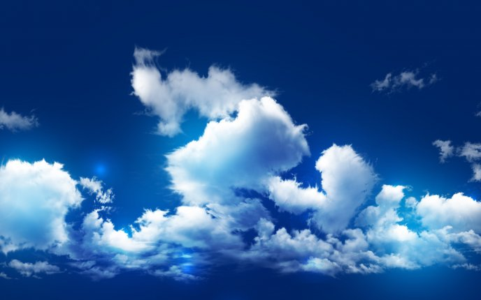 Wonderful big fluffy clouds in the light of sunshine