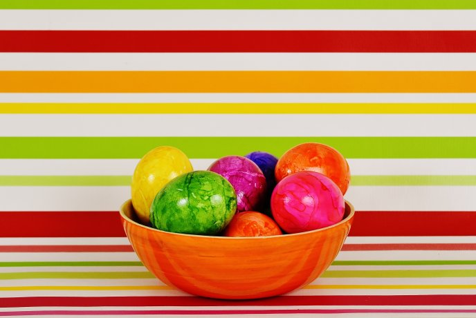 Easter eggs in a basket - Colorful background