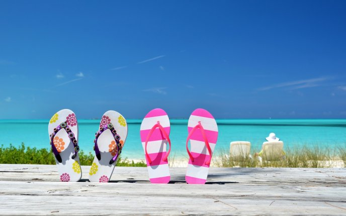 Colorful flip flops perfect for summer time and sand beach