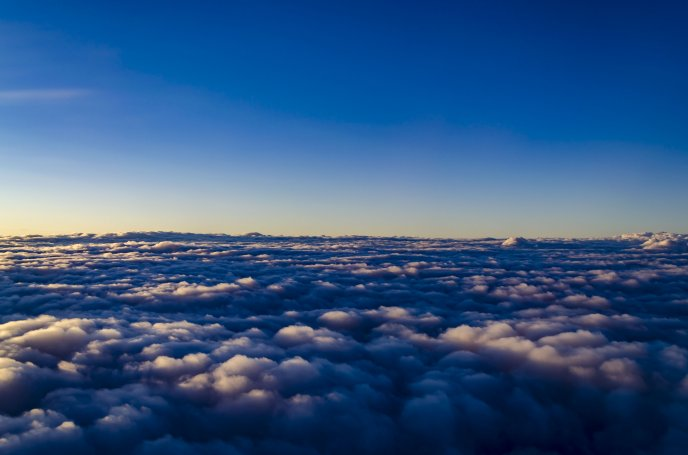 A view above the clouds at noon