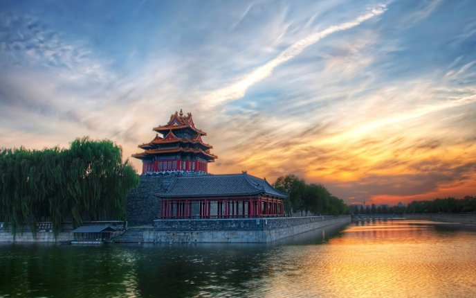 Wonderful sunset over an Asian building - HD holiday summer