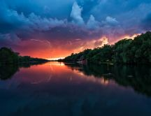 Sunset storm over the river