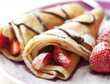 Delicious pancakes with strawberries