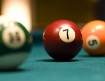 Red billiard ball number 7