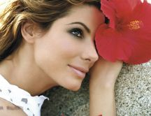 Sandra Bullock with a beautiful red flower