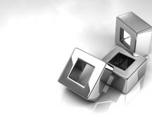 Three shiny silver cubes