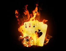 Four poker aces and chips in fire