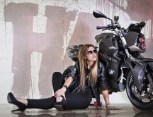 Blonde woman model with a BMW F88 Predator Motorcycle