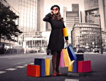 Shopping time - female on the street with colorful bags