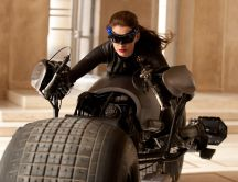Catwoman on a huge dark bike - The dark knight rises movie