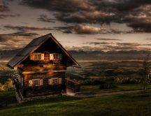 Storey wooden house on top of hill HD wallpaper