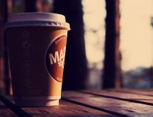 Coffee in a paper cup close up HD wallpaper