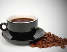 Delicious coffee in a black cup HD wallpaper