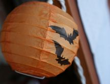 Halloween lantern with bats on it