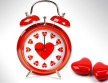 Love clock full with red hearts HD wallpaper
