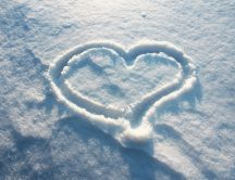 Heart shape in white and fluffy snow HD wallpaper