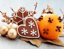 Decorated orange and Christmas cookies in a lovely setting