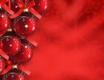 Red Christmas ornaments on a red background HD wallpaper