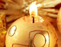 Golden candle in shape of a Christmas ball HD wallpaper