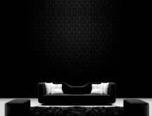 Black sofa on a dark room HD wallpaper