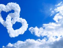 Two hearts mated - formed ​​of clouds on the sky