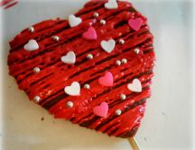 Biscuit in shape of heart frosting with candies