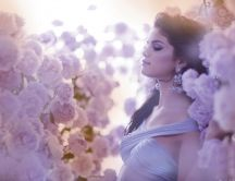 Selena Gomez in a garden full of pink roses