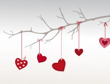 Tree adorned with red hearts