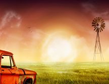 Orange old car on a green field - retina wallpaper